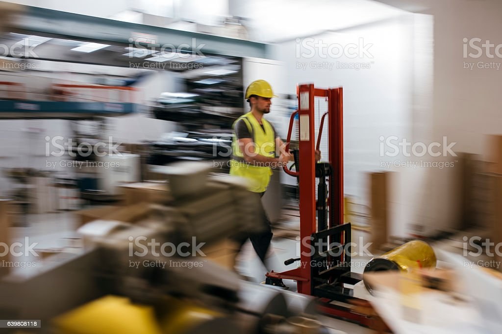 Working in production hall stock photo
