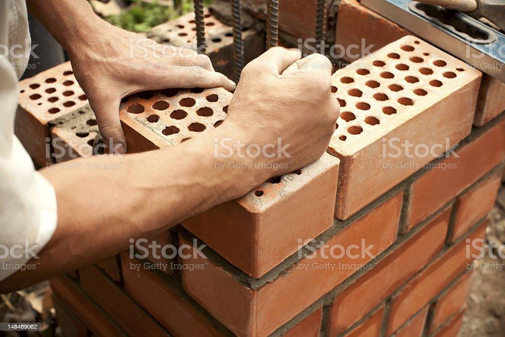 Working in progress. Bricks laying stock photo