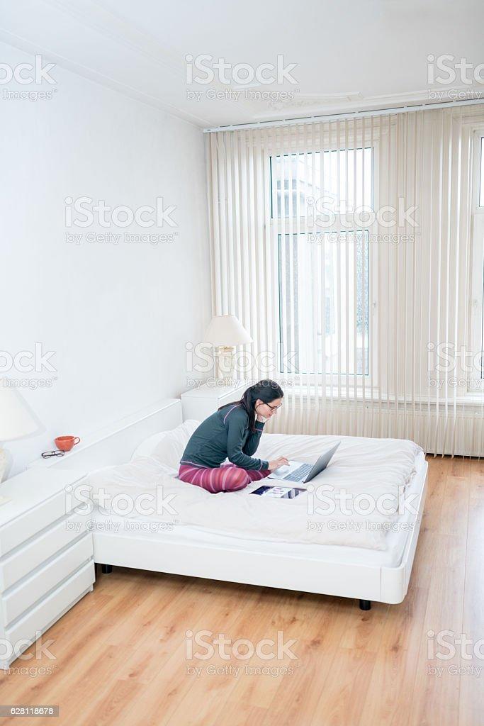 Working in the bedroom stock photo