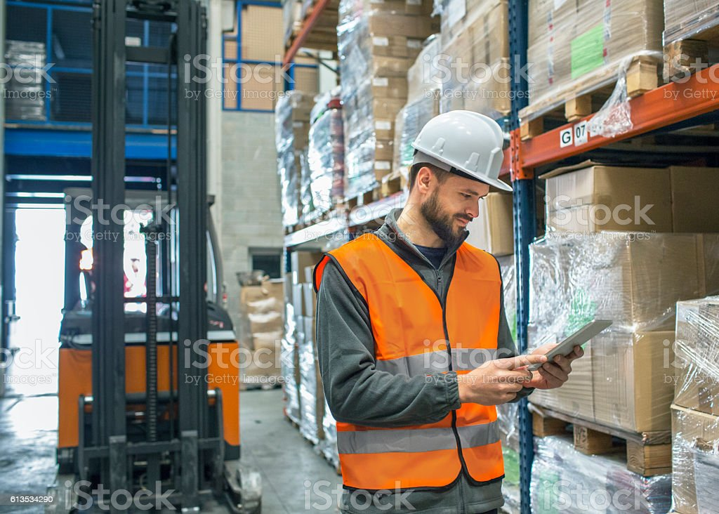 Working in warehouse checking delivery stock photo