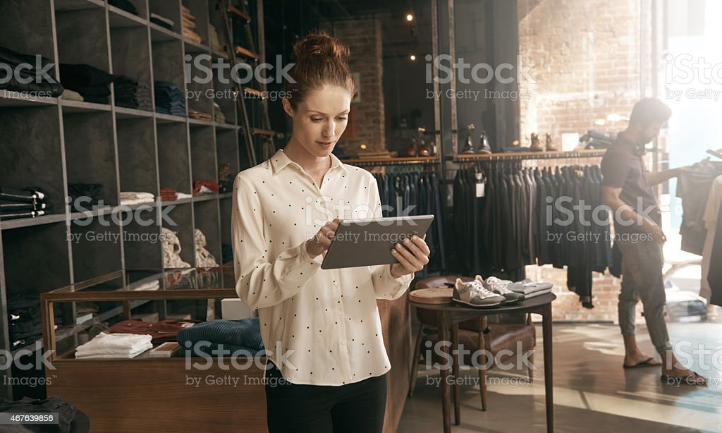 Working in-store and online stock photo