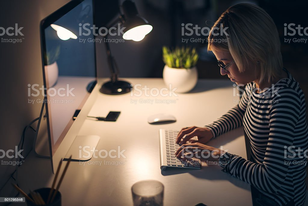 Working late at night stock photo