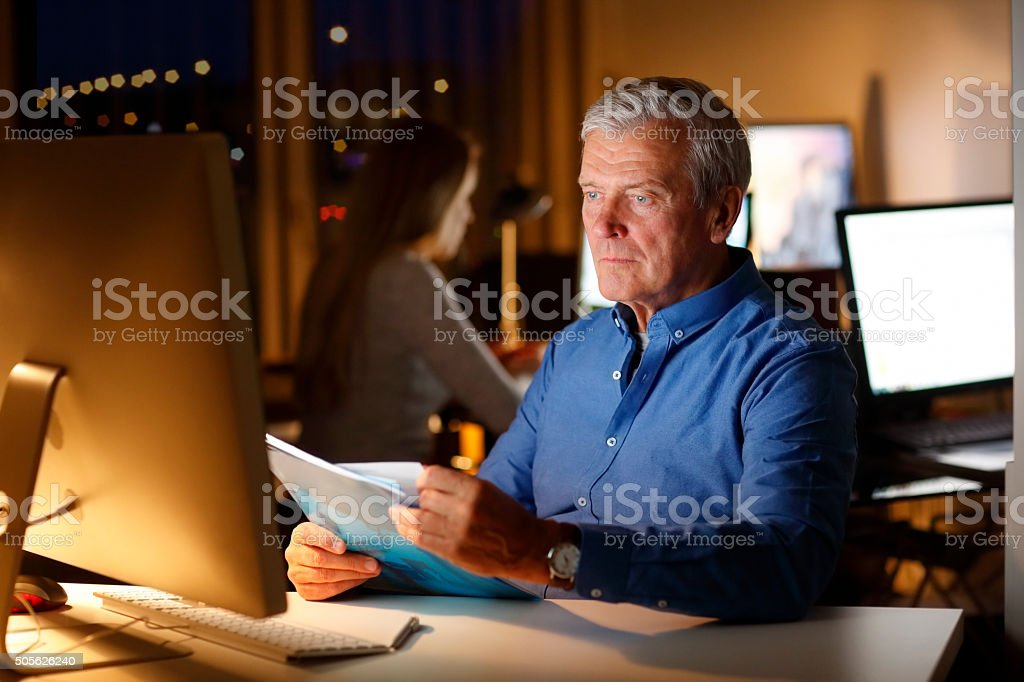 Working late at office stock photo