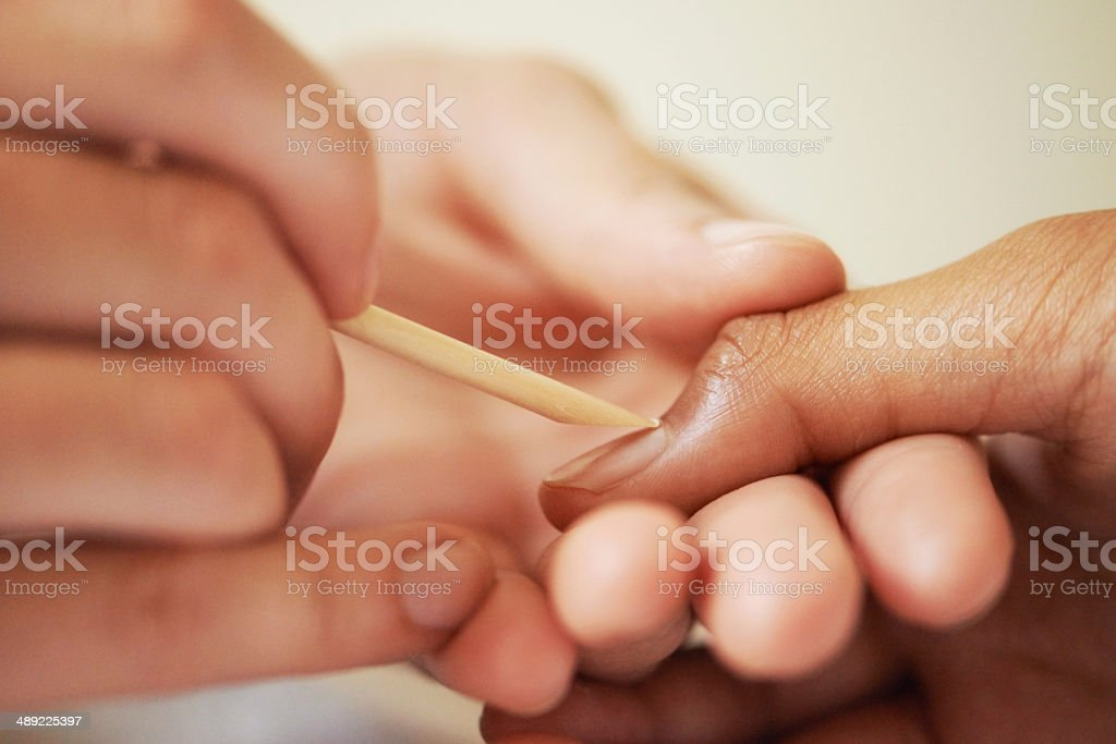 Working magic on her nails royalty-free stock photo