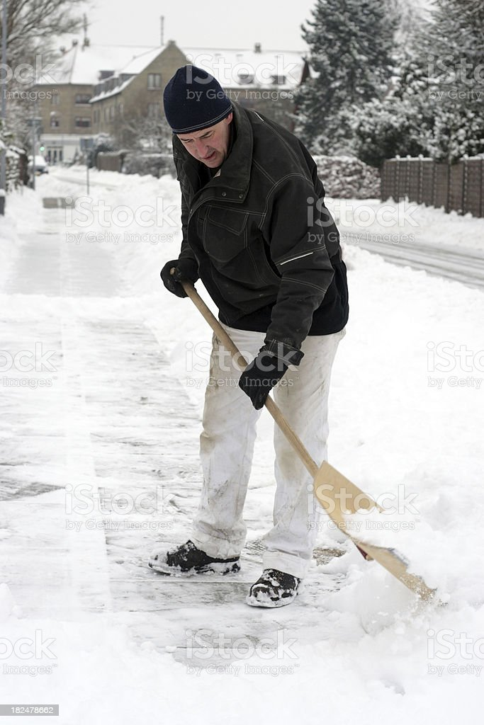 Working man clear the roads of snow stock photo
