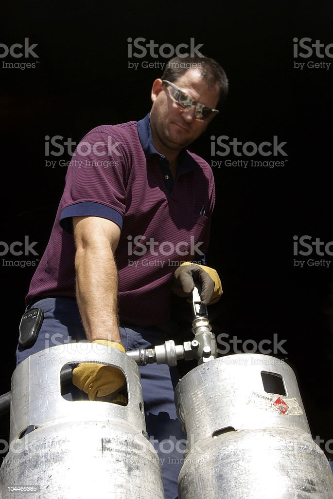 Working man filling propane royalty-free stock photo