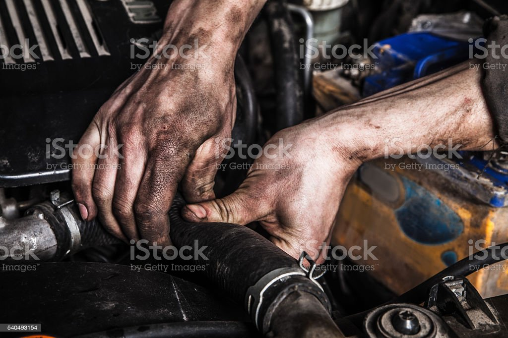 Working man fix engine stock photo