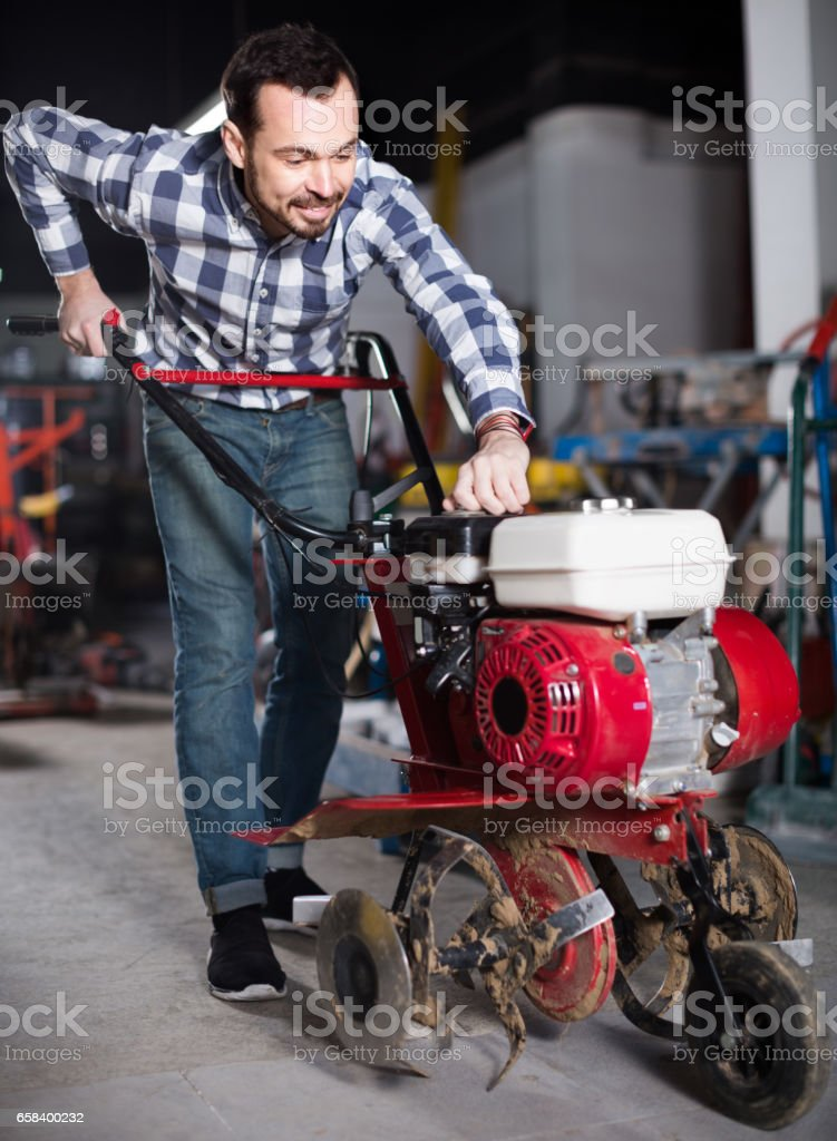 Working man practicing his skills and using plough stock photo