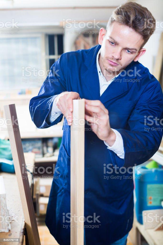Working man preparing chipboard for work stock photo