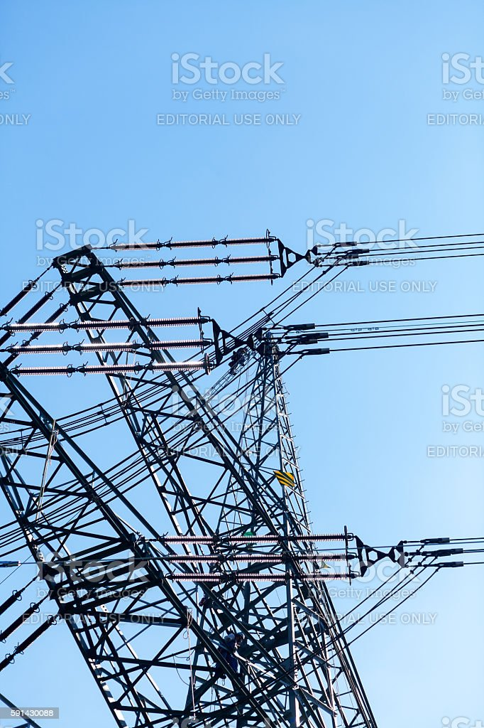 Working men on power pole stock photo