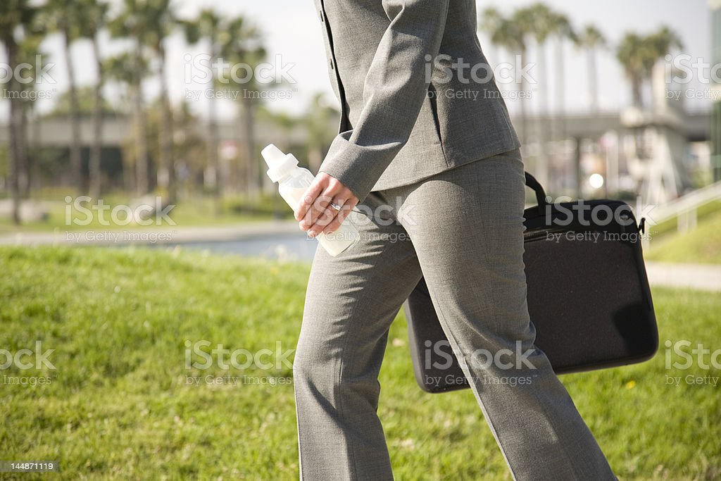 Working mom with bottle. royalty-free stock photo