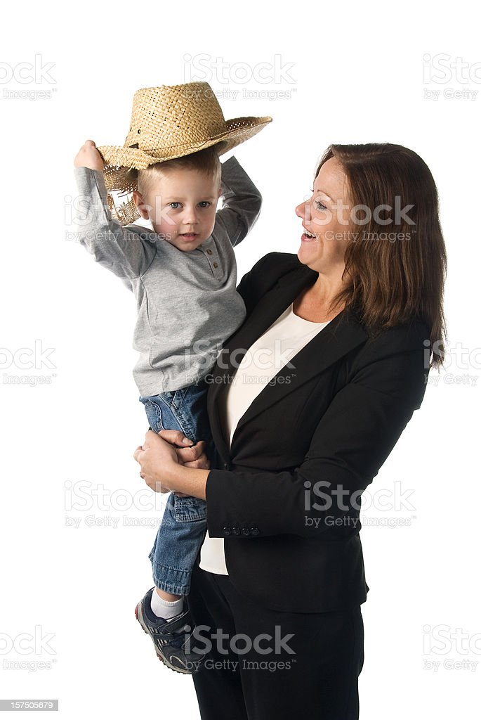 Working mother concept: businesswoman holding her son stock photo