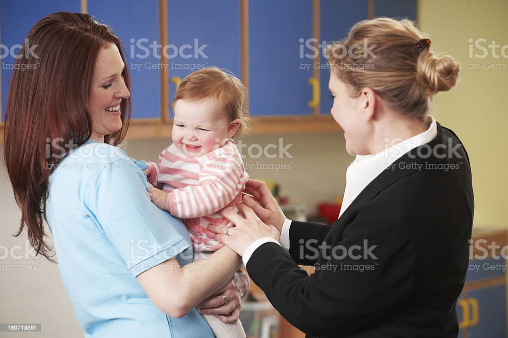Working Mother Dropping Child Off At Nursery royalty-free stock photo