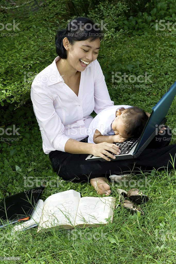 working mother playing with baby royalty-free stock photo