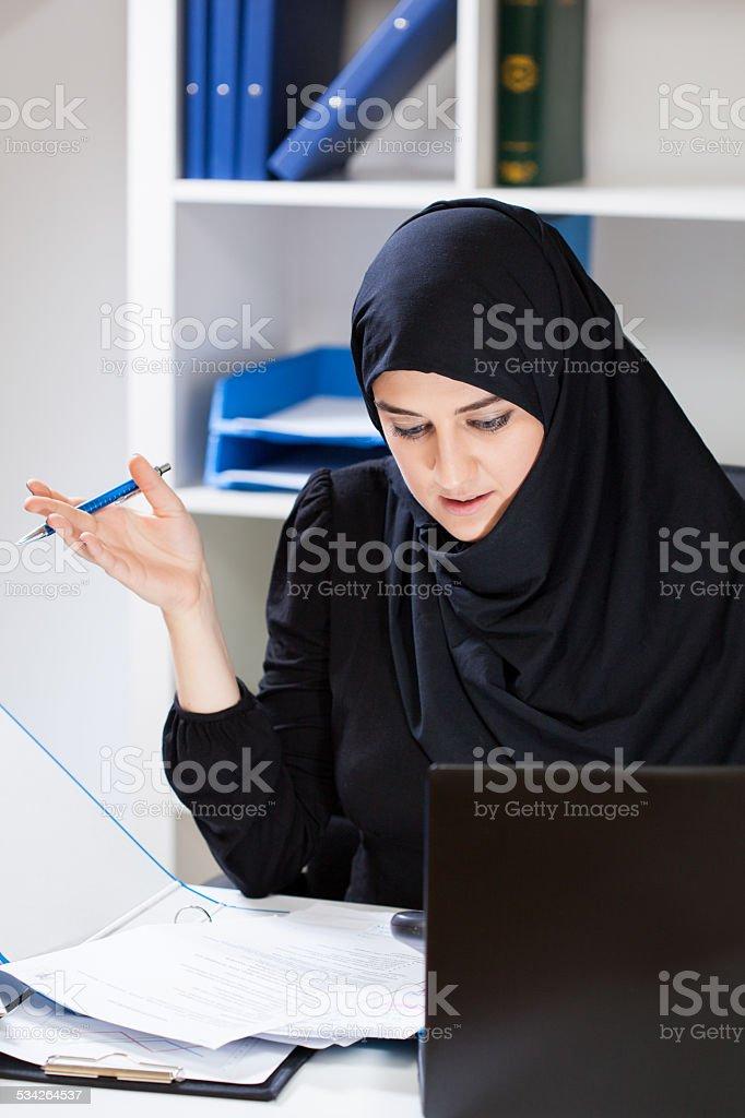 Working muslim female stock photo