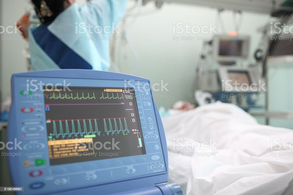 Working nurse with the patient in ICU stock photo
