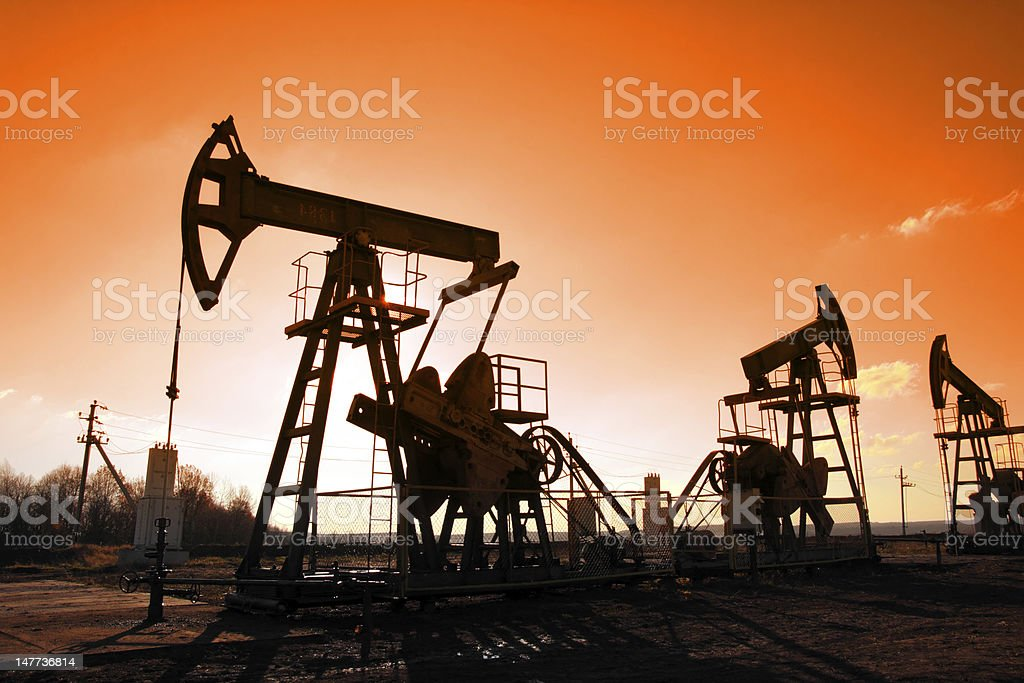 working oil pumps silhouette royalty-free stock photo