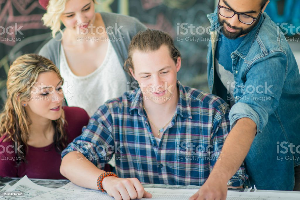 Working on a Blueprint stock photo