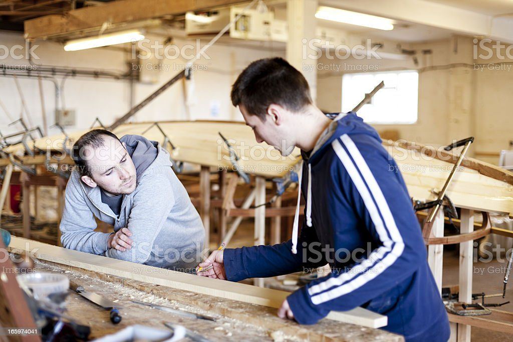 Working on a boat build stock photo