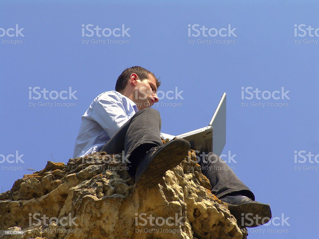 working on a cliff royalty-free stock photo