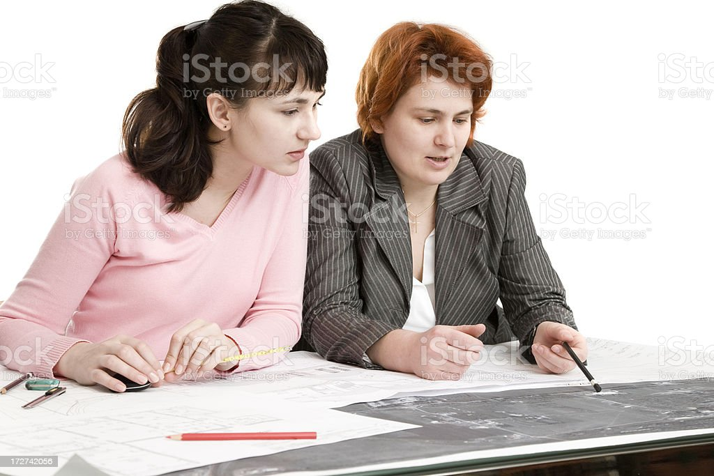 Working on a construction plan royalty-free stock photo