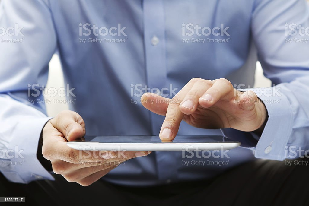 Working on a digital tablet stock photo