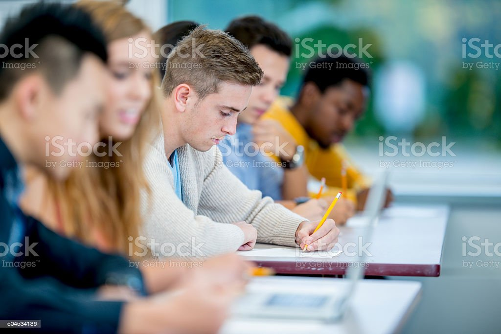Working on a Homework Assignment stock photo