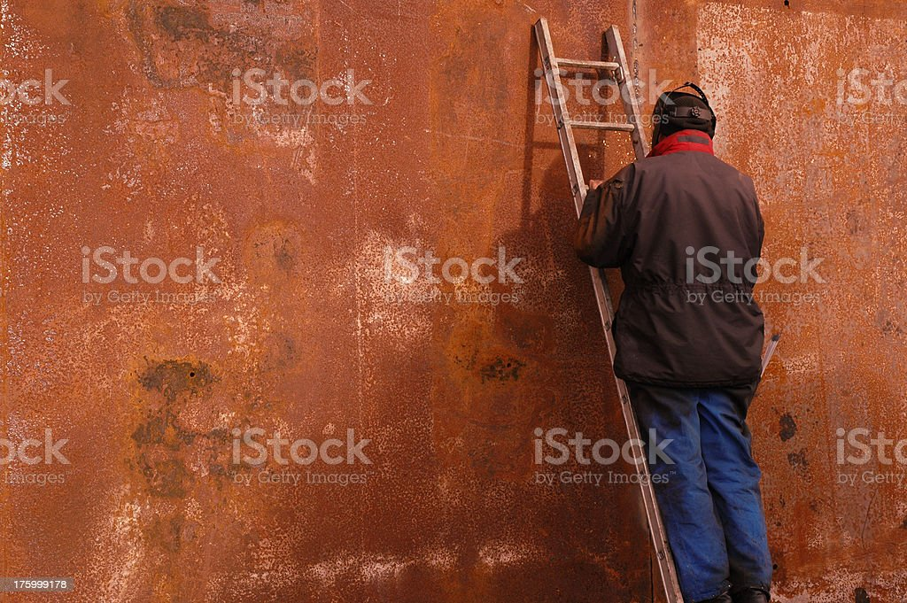 Working on a ladder royalty-free stock photo