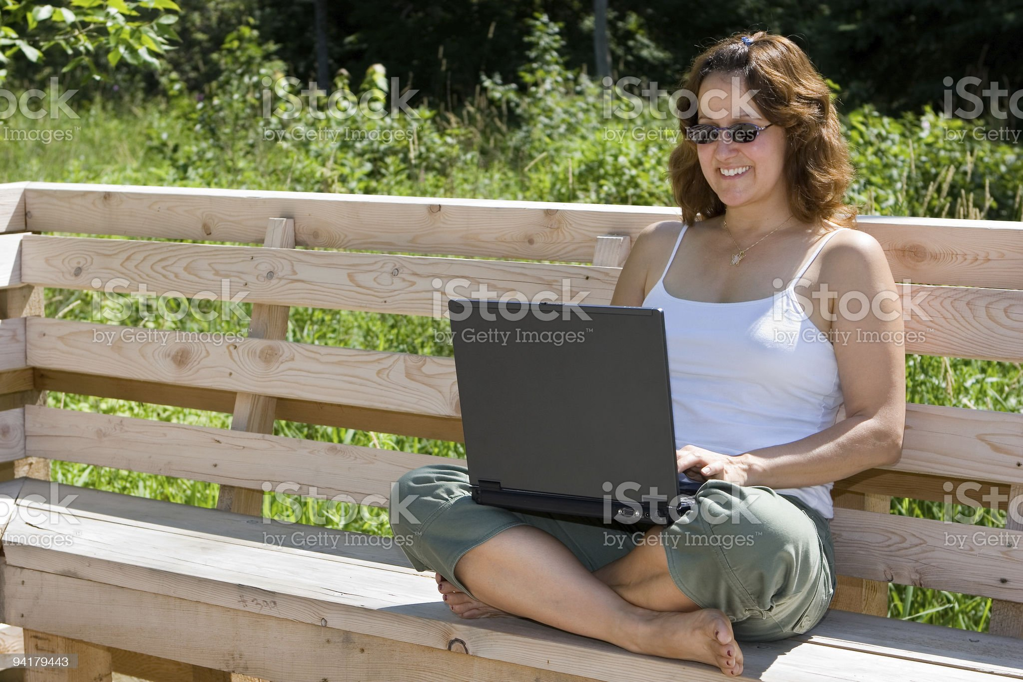 Working on a laptop in the great outdoors royalty-free stock photo
