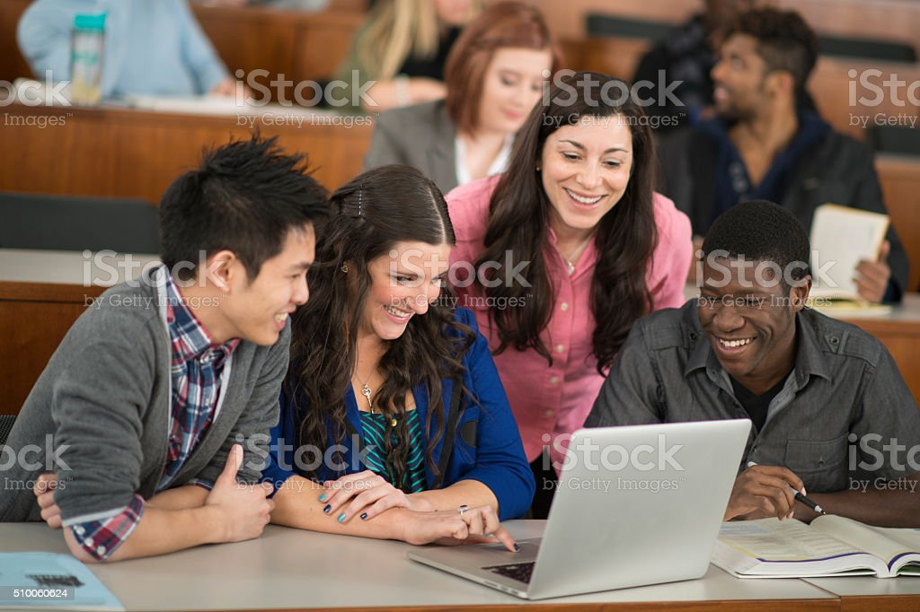 Working on a Laptop Together stock photo