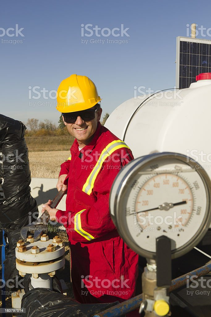 Working on a Pipe royalty-free stock photo