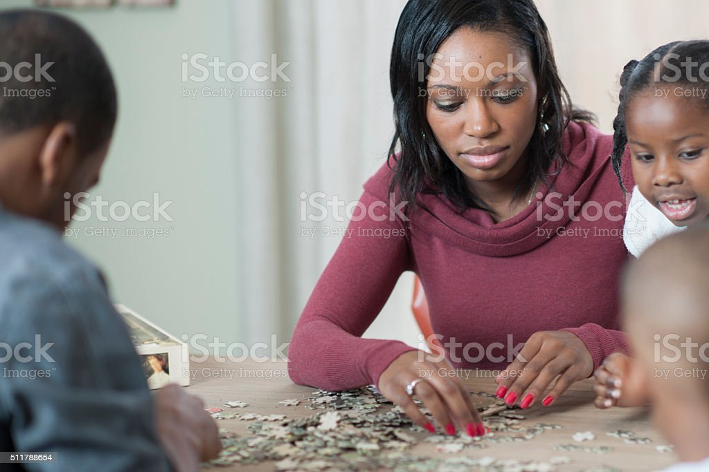 Working on a Puzzle as a Family stock photo