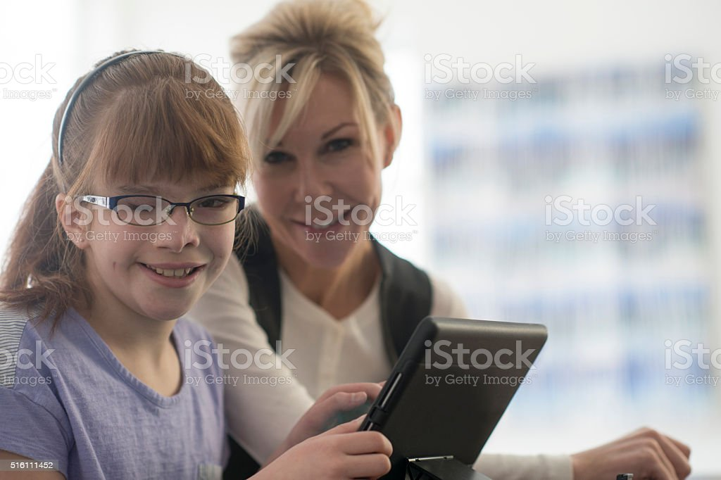 Working on a Tablet with New Glasses stock photo
