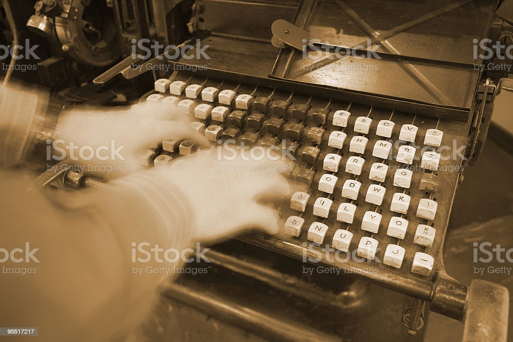 working on an old linotype royalty-free stock photo