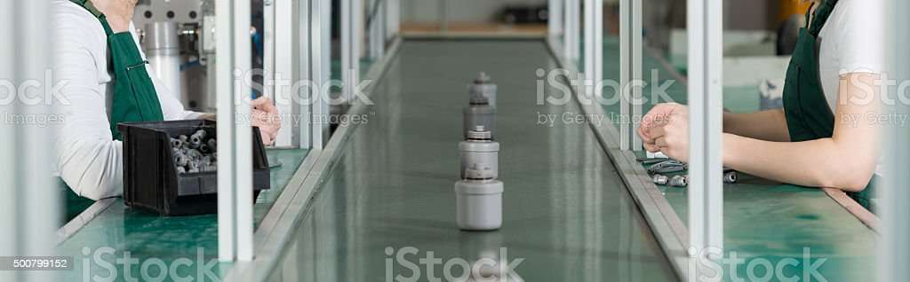 Working on assembly line stock photo