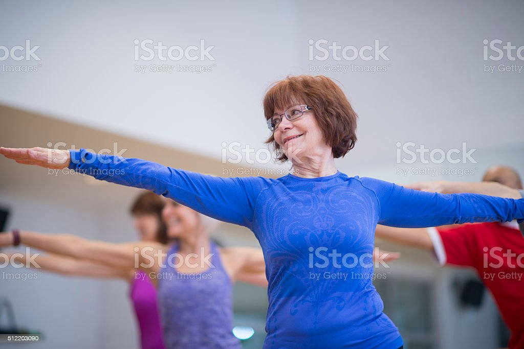 Working on Balance in a Yoga Class stock photo