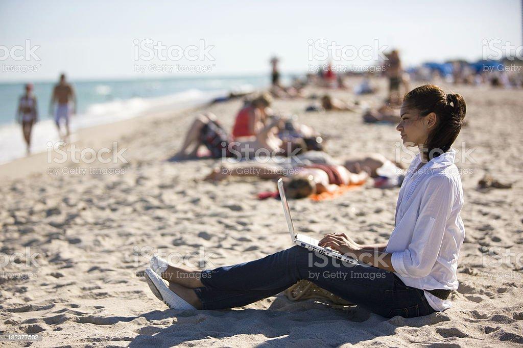 Working on beach royalty-free stock photo