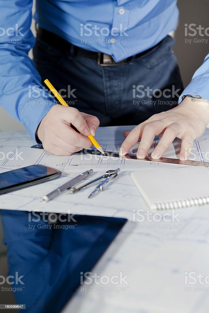 Working on Blueprints royalty-free stock photo