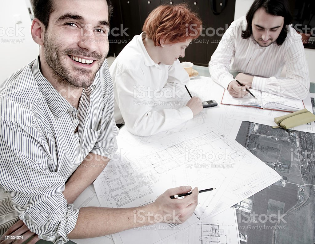Working on construction plans royalty-free stock photo