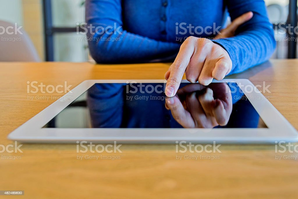 Working on digital tablet stock photo