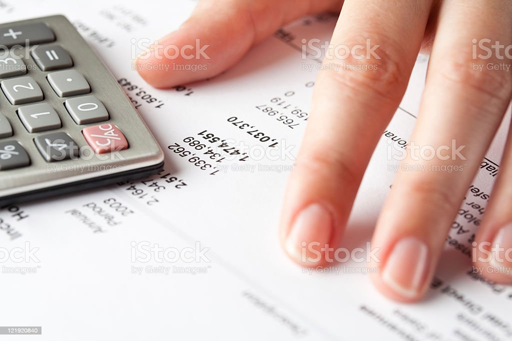 Working on financial papers. stock photo