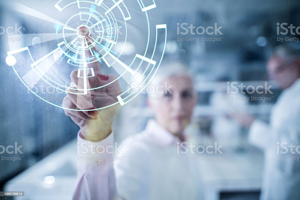 Working on futuristic innovation on a touch screen. stock photo