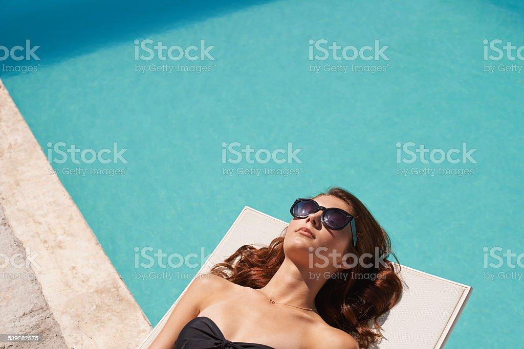 Working on her tan stock photo