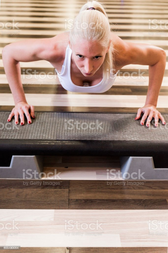Working on her upper body stock photo