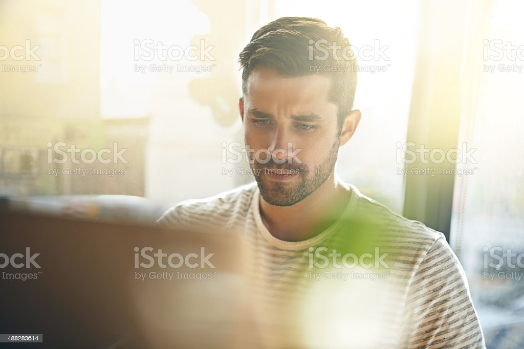 Working on his latest blogpost stock photo