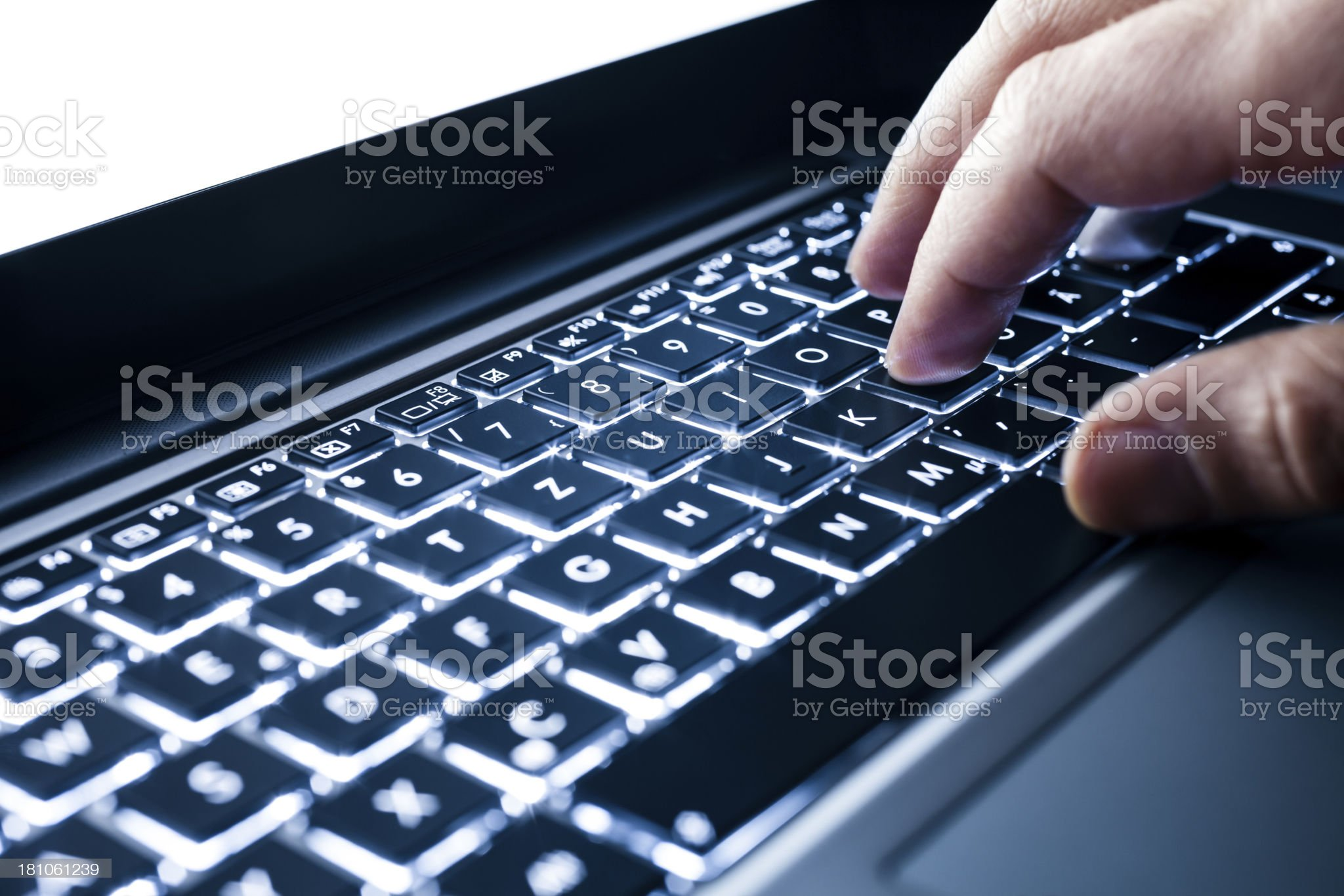 Working on illuminated laptop - Keyboard Hand Typing royalty-free stock photo