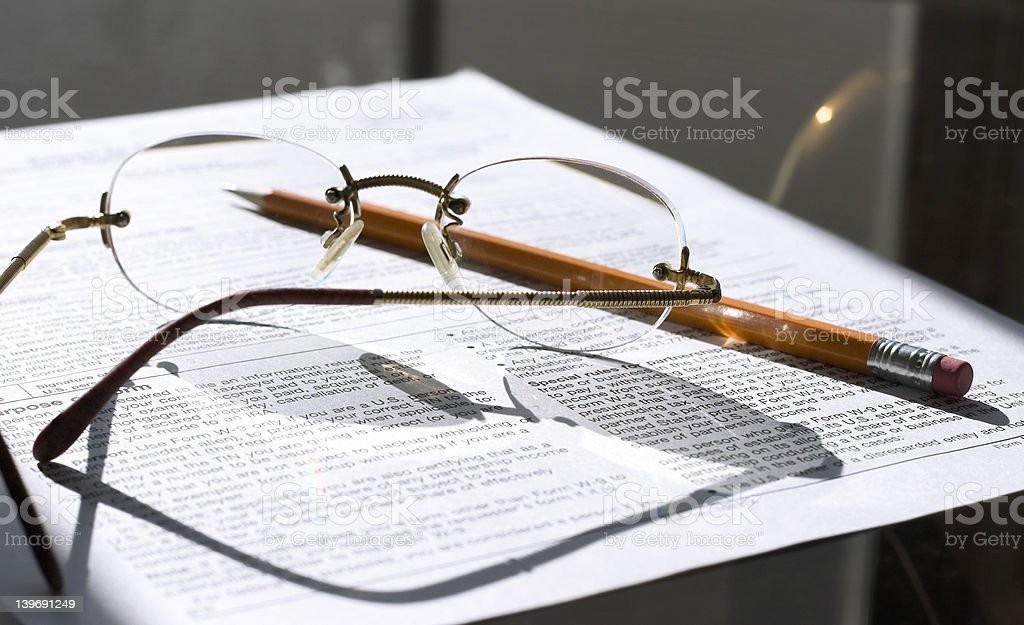working on important papers stock photo