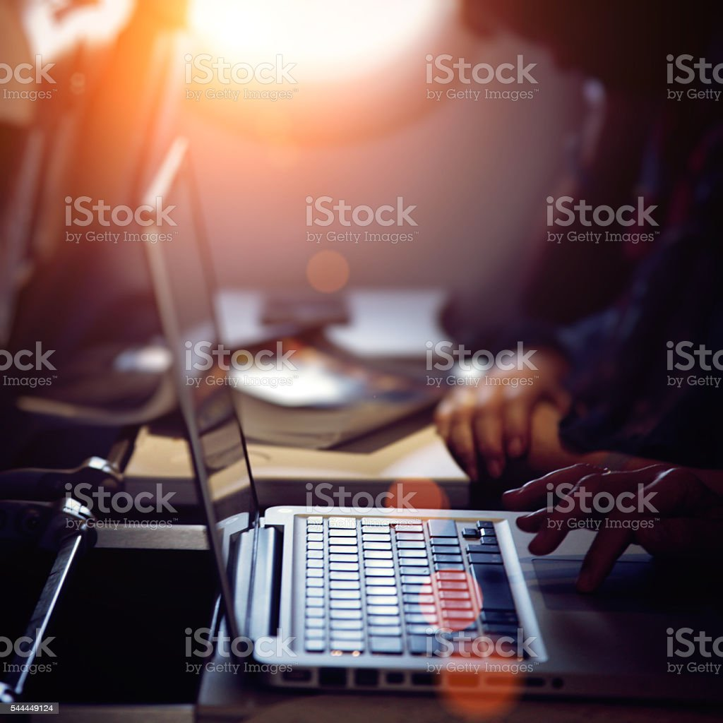 Working on laptop computer in airplane concept stock photo