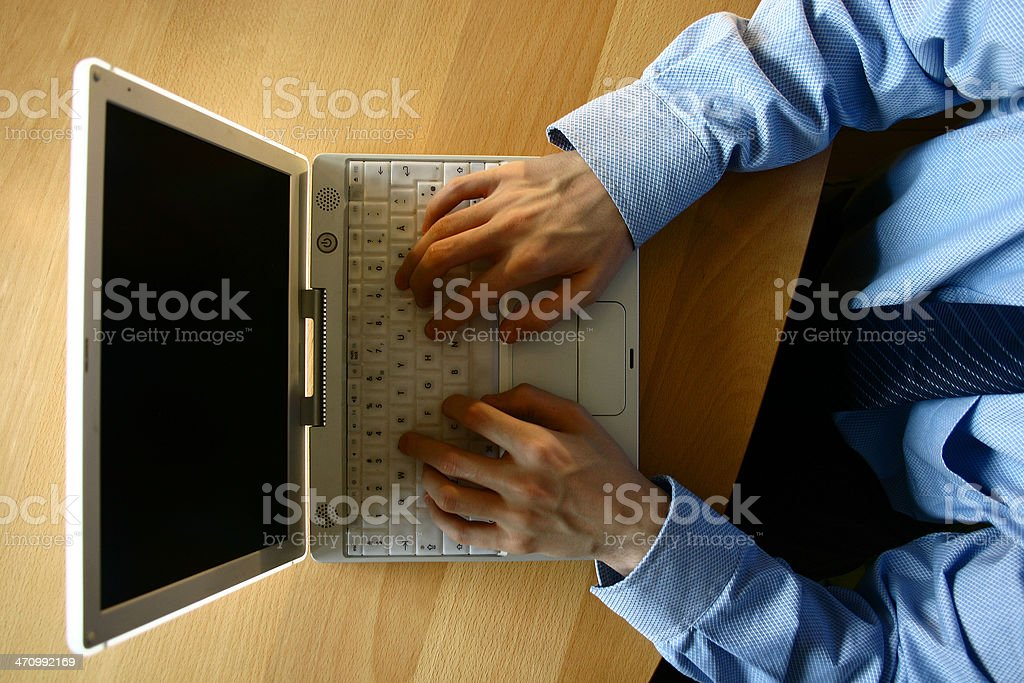Working on laptop - from above stock photo