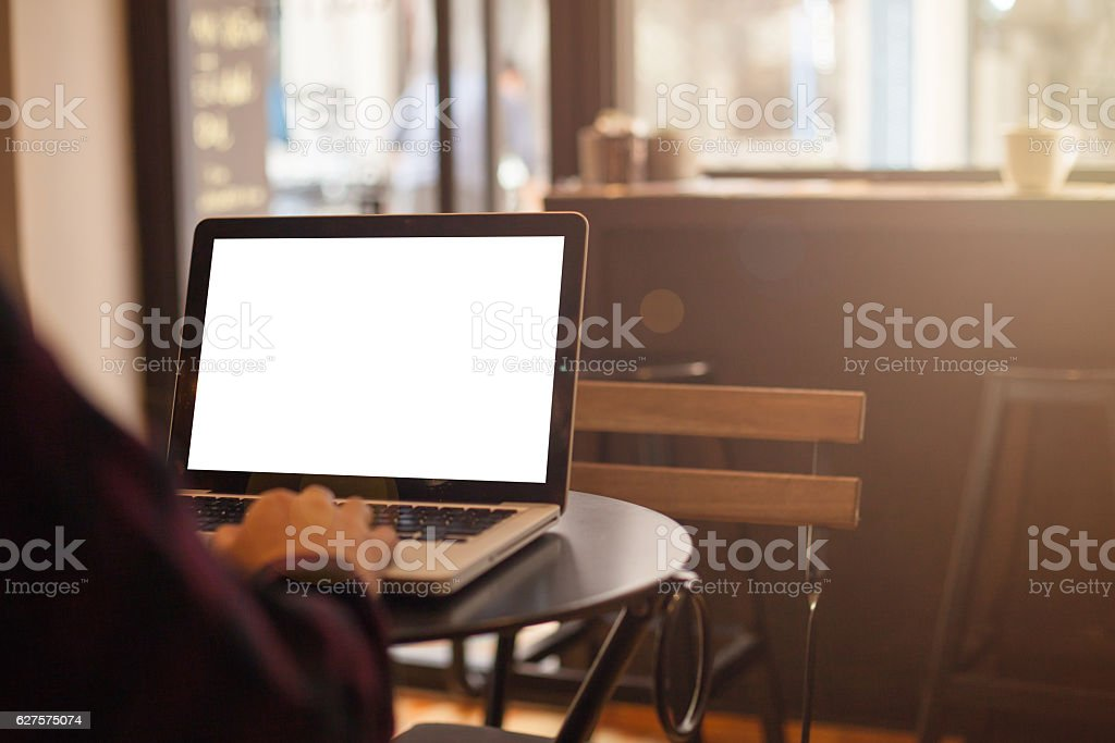 working on laptop in a coffee shop stock photo